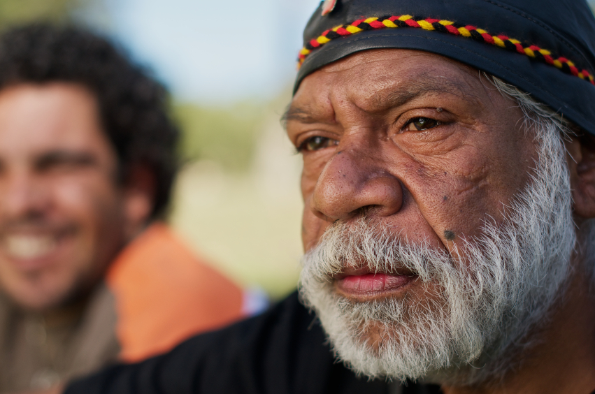 Aboriginal Australian Elder with a smiling man in the background